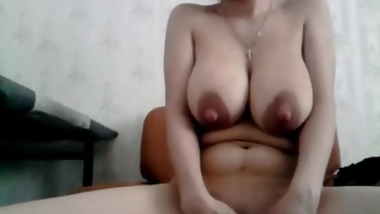Big booby mommy teases with her big tits and fingers her pus